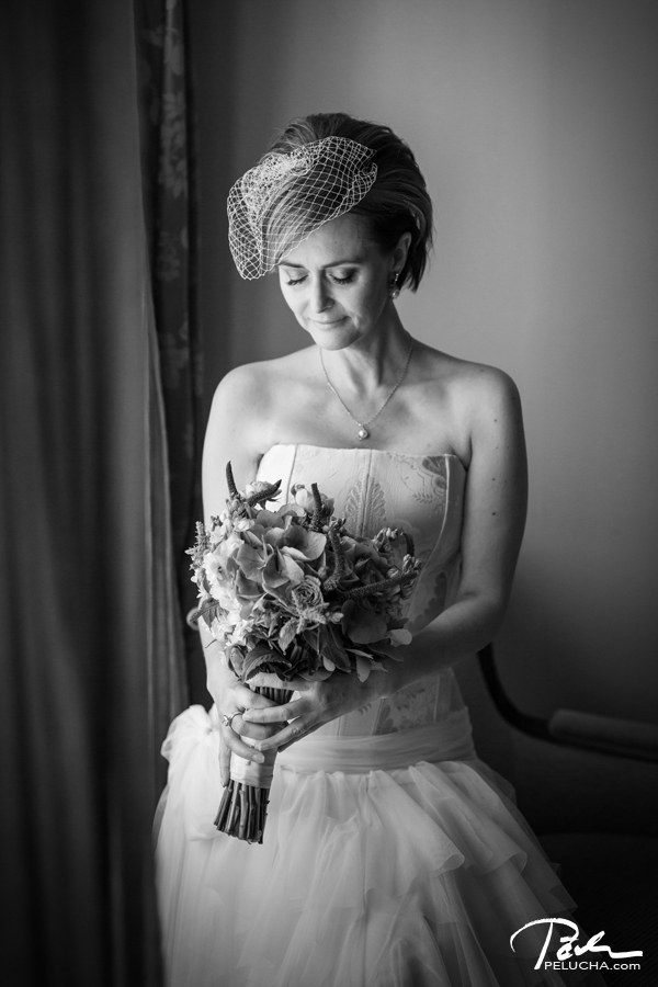bride with aa bouquet standing by the window