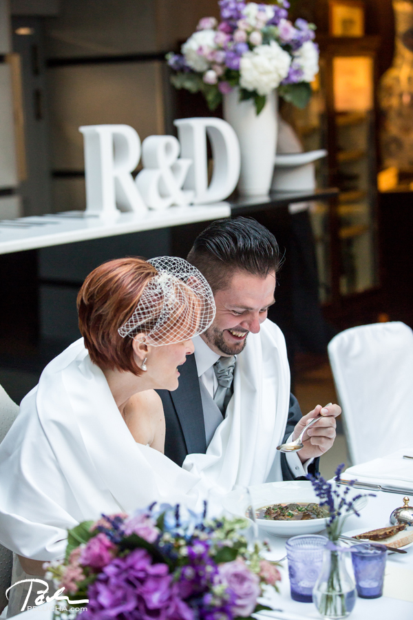 bride and groom eating soup together and laughing